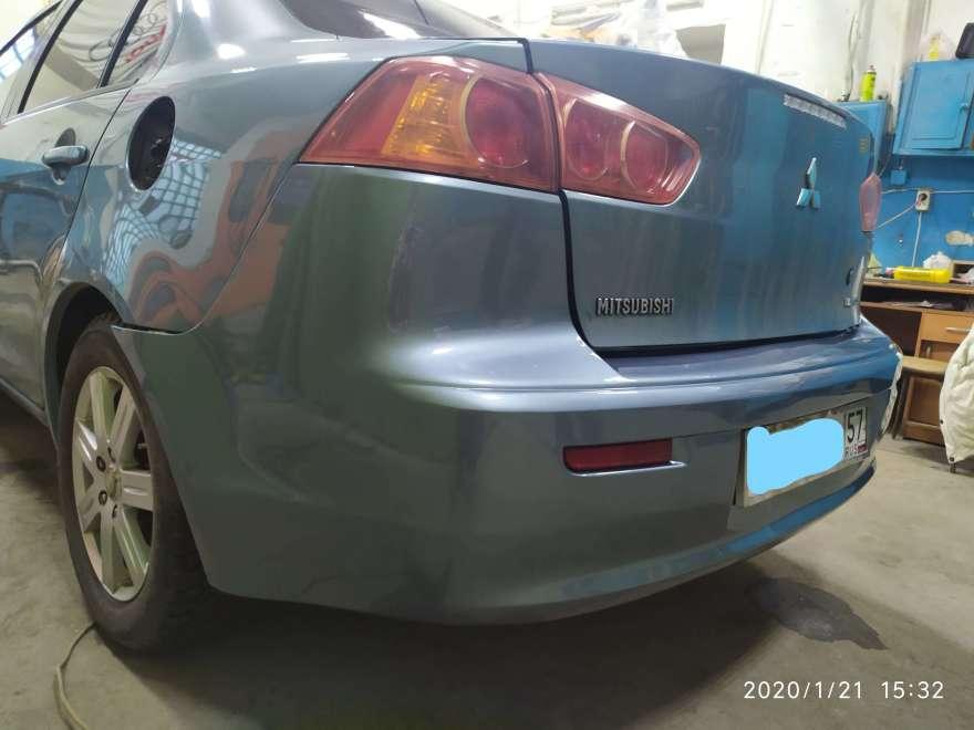 Фото примера ремонта заднего бампера Mitsubishi