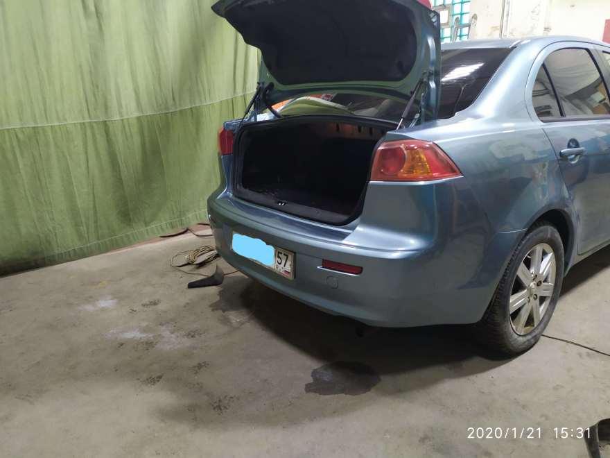 Фото результата восстановления бампера Mitsubishi